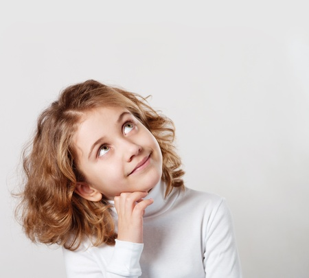 innocent girl: Portrait of cute little girl with dream Stock Photo