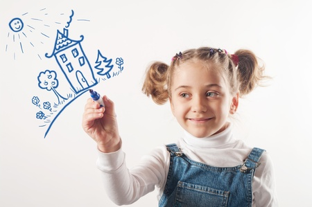 Adorable girl drawing a house