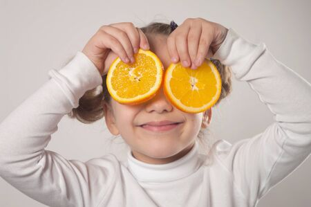 happy little girl with orange photo