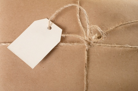 Parcel tied with string with address label attached  photo