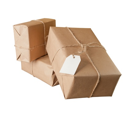 craft product: pile parcel wrapped with brown kraft paper isolated