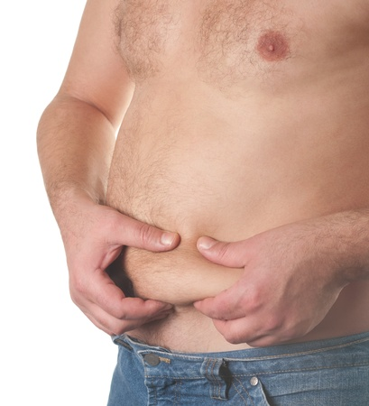 gut: Man holding his big fat belly isolated on white background