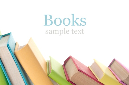 white book: Many colorful books in a row creating a border frame. Isolated on white.  Stock Photo