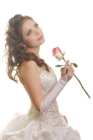 portrait of beautiful  bride with rose  photo