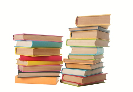 school things: close up of stack of colorful books on white background