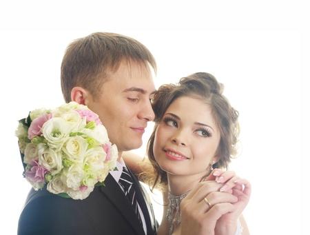 Elegantnye newly-married couple on the isolated white background  photo