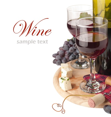 wine tasting: a glass of red wine and grape over white (with sample text)  Stock Photo