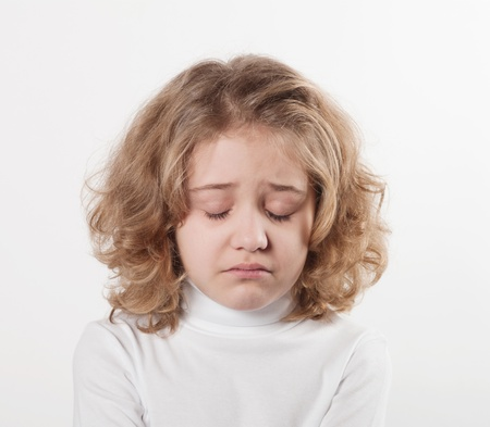 little sad girl after crying  photo