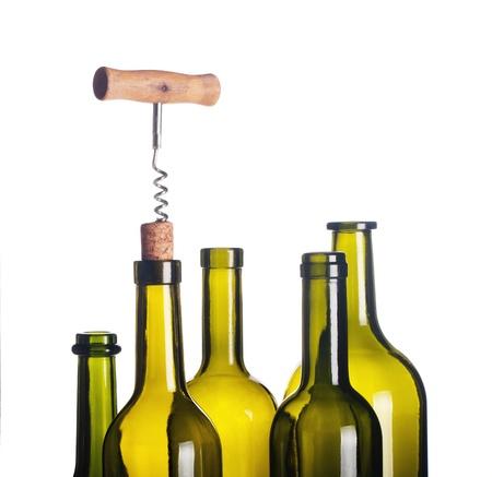 background with wine bottles, corkscrew and cork Standard-Bild