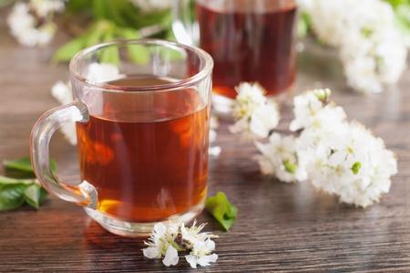 english tea: cup of fresh tea on the table