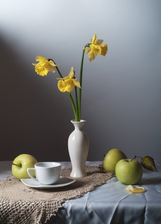 Still Life daffodils and green apples photo