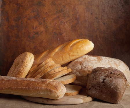 different types of bread on a dark background photo