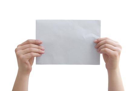 hands holding the paper on a white background photo