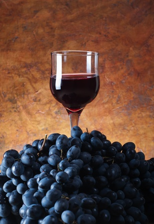 glass of wine on a pile of grapes Stock Photo - 13356917