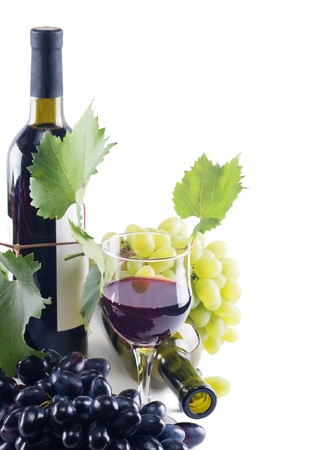 bottle of wine, grapes and a glass of red wine on a white background