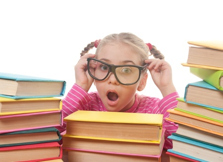 a little girl and books, back to school concept, isolated over white photo