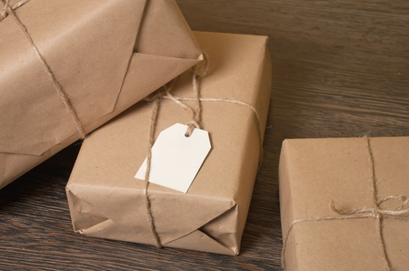 craft product: pile parcel wrapped with brown kraft paper and tied with twine  Stock Photo