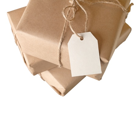 ship parcel: parcel wrapped with brown paper tied with rope isolated on white background