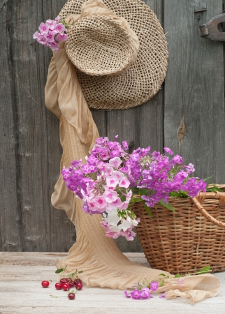 Rustic image of a gardeners straw hat and basket  photo