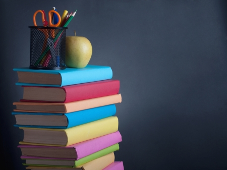 Books on the background of the school board Stock Photo - 14526172