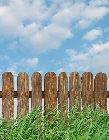 fence with green grass and blue sky  photo