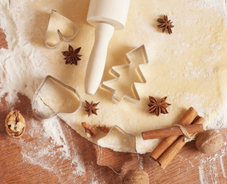 baking background with dough, spices and cookie cutters  photo