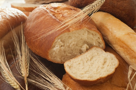 fresh bread and wheat spikelets photo