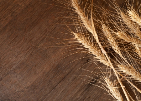 golden wheat on the old wooden background photo