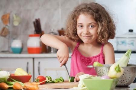 a little dinner: girl preparing healthy food vegetable salad  Stock Photo