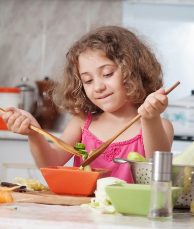 girl preparing healthy food vegetable salad  photo