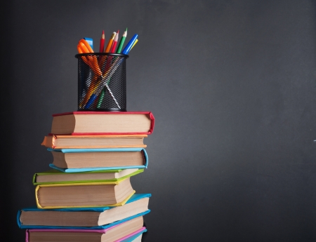 Books on the background of the school board  Stock Photo - 14809197