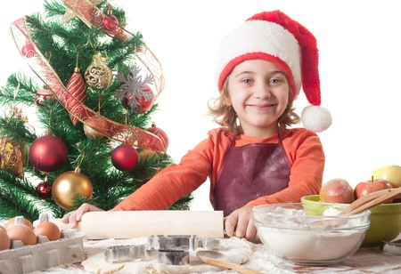 christmas cooking: Merry Christmas - little girl baking Christmas cookies