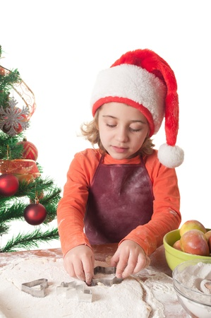 Merry Christmas - little girl baking Christmas cooki photo