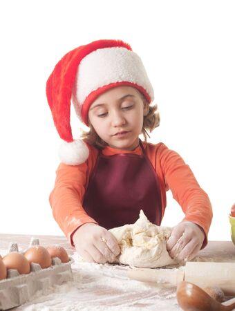 haciendo el amor: Feliz Navidad - niña hornear galletas de Navidad Foto de archivo