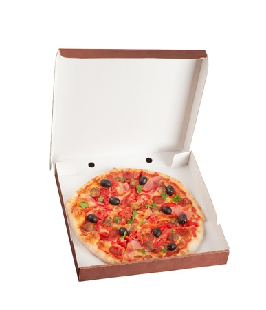 Tasty pizza in box isolated on white  photo