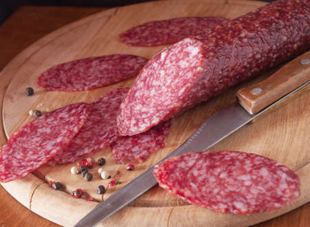salami close up on a wood board  photo