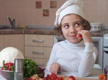girl preparing healthy food vegetable salad photo