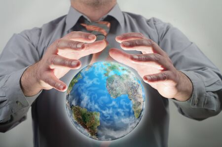 businessman holding planet earth  photo