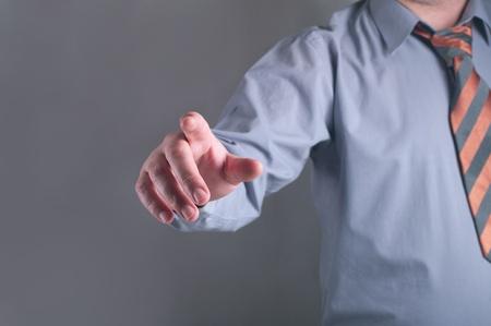 business man pushing an imaginary button Stock Photo - 18166217