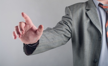 business man pushing an imaginary button