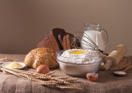 still life with flour, bread  milk and wheat photo