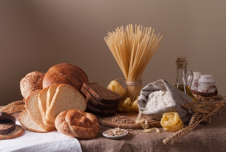 still life with bread, pasta and wheat photo