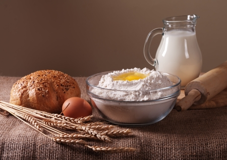 milk jugs: still life with flour, bread  milk and wheat Stock Photo
