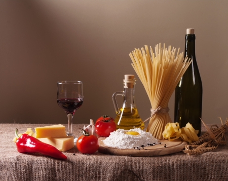 abundance: still life with pasta, vegetables and wine