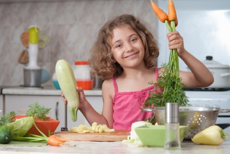 child  preparing healthy food vegetable salad photo