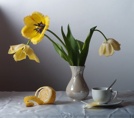 tulips in vase: Still life with yellow tulips