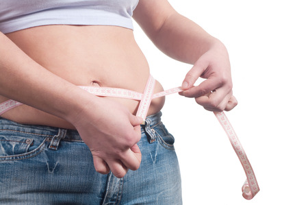 fat woman measuring her stomach