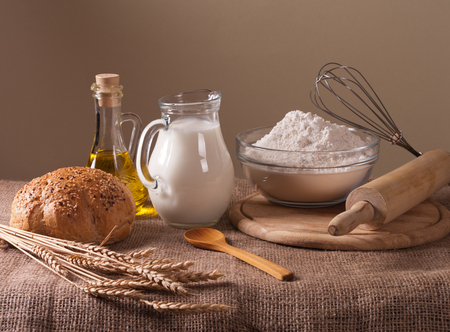 still life with flour, bread. milk and wheat photo