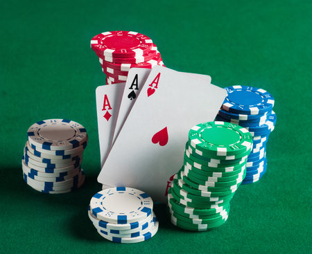 Poker chips on green  background photo