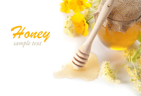 blossom honey: jar of honey and stick Stock Photo
